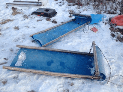 sled made from plastic barrel