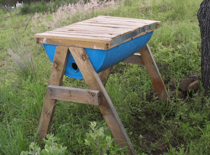 top bar bee hive made from plastic barrel - plastic barrel ideas