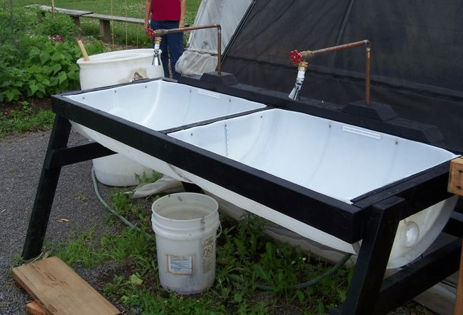 11 creative ideas for re using large plastic drums diy for Homemade fish cleaning table