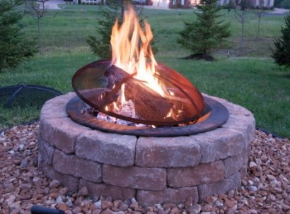 fire pit with screen and logs